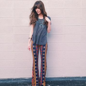 grey t shirt with navy blue and orange tribal printed bell bottom yoga pants