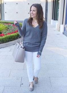 grey v neck sweater with white slim fit jeans