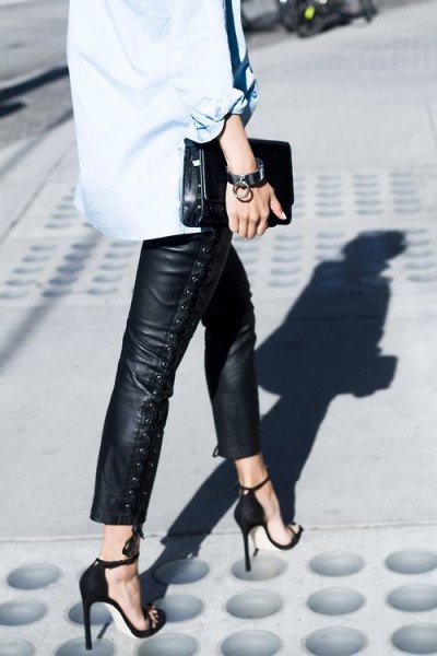 light blue button up shirt with cropped leather pants and heels