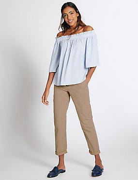 light blue off the shoulder blouse with beige slim fit cuffed chinos