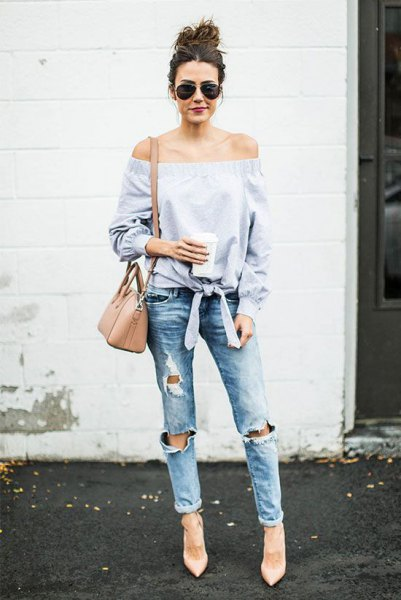 light blue off the shoulder knotted blouse with boyfriend jeans and blush shoulder bag