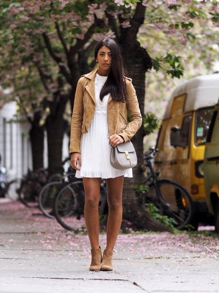 light brown suede jacket with white babydoll pleated dress
