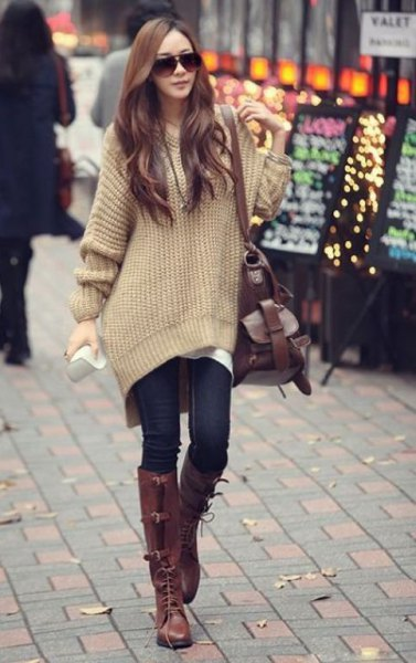 light green chunky oversized sweater with dark blue skinny jeans and knee high boots