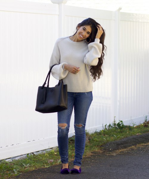 light grey crew neck sweater with ripped jeans and navy blue velvet flats
