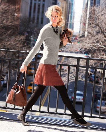 light grey form fitting cashmere sweater with red pleated mini skirt