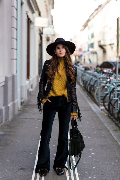 lime green turtleneck sweater with black leather jacket and flared velvet jeans
