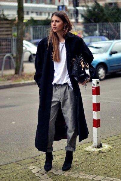 long black wool coat with white sweatshirt and grey straight leg pants