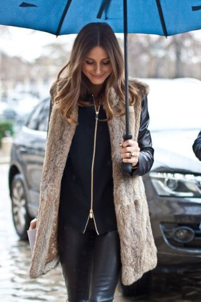long light brown vest with black biker jacket and leather leggings