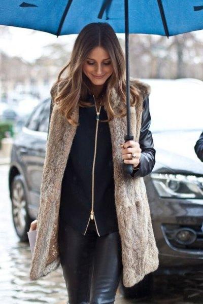 long light brown vest with black biker jacket and leather leggings