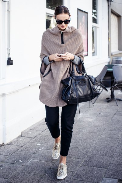longline zip up cape sweater with black cropped jeans