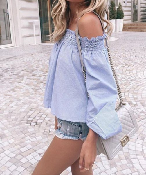 off the shoulder light blue blouse with mini denim shorts and pale pink purse
