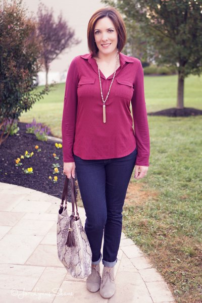 pink blouse with navy blue cuffed jeans and grey suede ankle boots