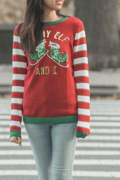 red and white striped crew neck knit sweater with light grey skinny jeans