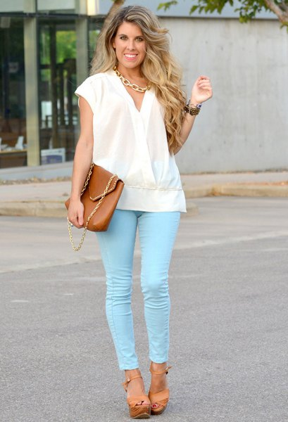white cap sleeve wrap blouse with colored skinny jeans