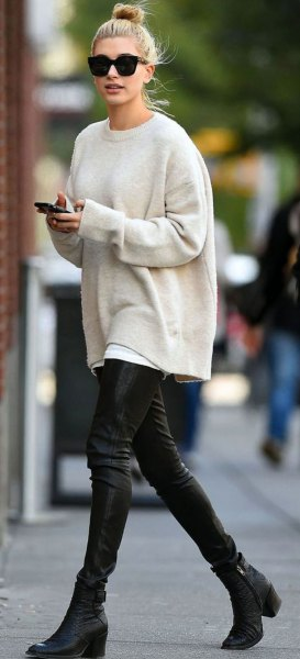 white crew neck chunky sweater with black leather pants