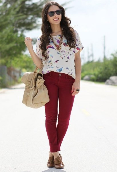 white floral printed short sleeve blouse with red slim fit jeans