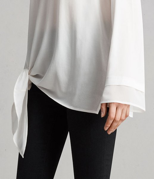 white knotted long wide sleeve chiffon tunic t shirt with black skinny jeans