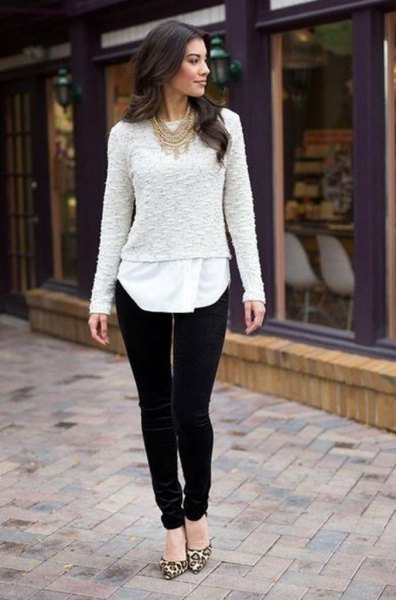 white lace sweater over tunic blouse and black velvet pants