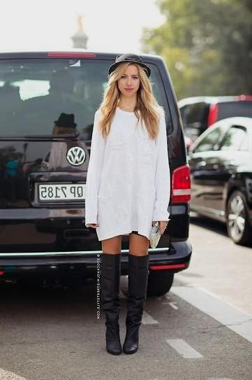 white long sleeve dress with black felt hat and leather boots