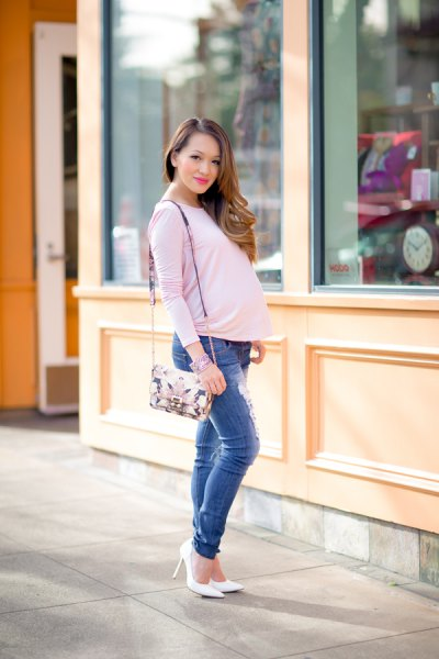white long sleeve maternity tee with blue slim fit ripped jeans