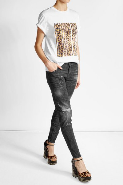 white print tee with black slim fit biker jeans
