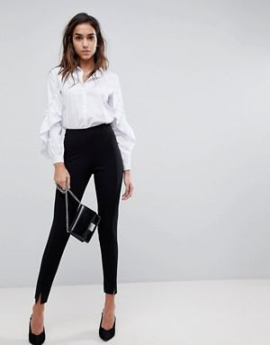 white puff sleeve button up shirt with black high rise chinos