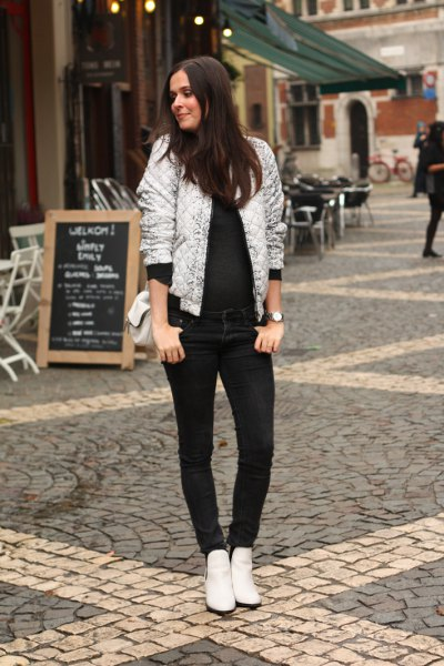 white shiny bomber jacket with all black outfit