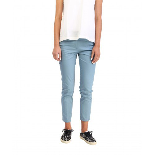 white sleeveless chiffon blouse with light blue cropped slim fit chinos