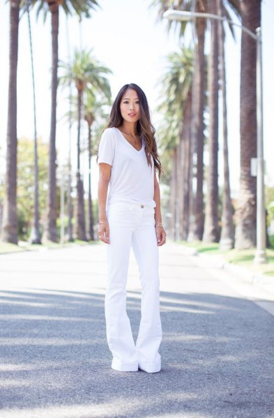 white v neck tee with white bell bottom jeans