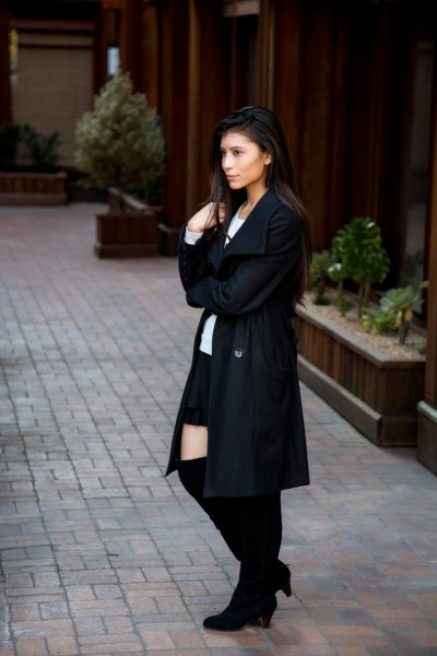wool coat with white print tee and black mini skirt