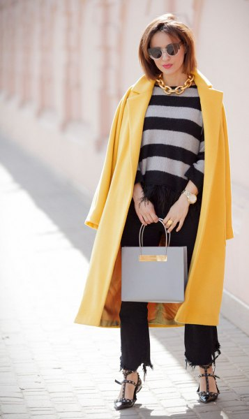 yellow maxi wool coat with black cropped and ripped jeans