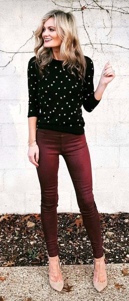 black and white polka dot crew neck sweater with jeans and pale pink heels