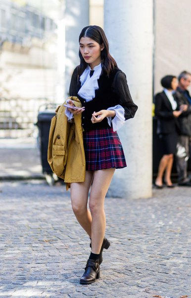 black blouse with light blue collar and red mini plaid skirt