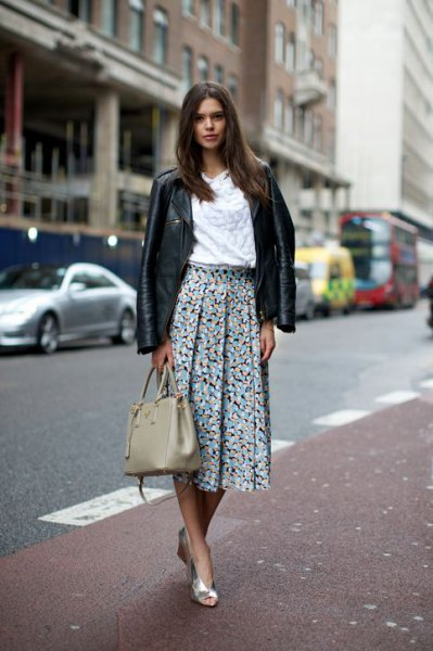 black leather jacket with white blouse and floral printed pleated skirt
