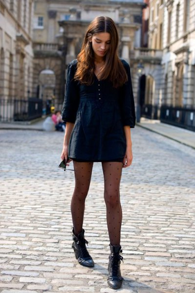 black three quarter sleeve mini pullover dress with leather ankle boots