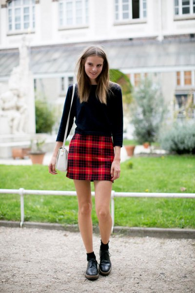 black three quarter sleeve sweater with red plaid mini skirt