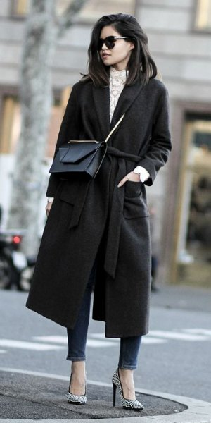 black walker coat with grey mock neck knit sweater and ankle jeans