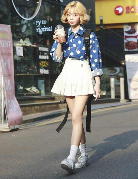 blue and white printed shirt with pleated skirt