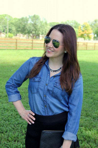 blue chambray button up shirt with black high rise jeans