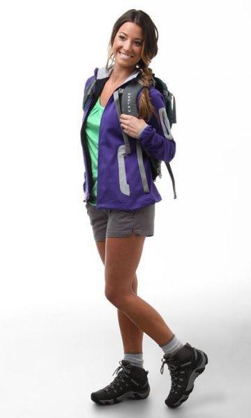 blue hiking jacket with light grey mini shorts