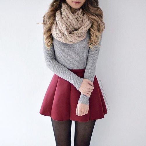 cable knit scarf with form fitting grey sweater and maroon pleated mini skirt