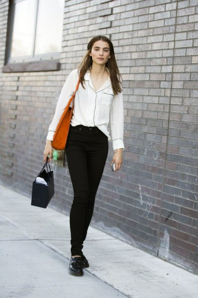 cream button up shirt with black skinny jeans and leather shoes