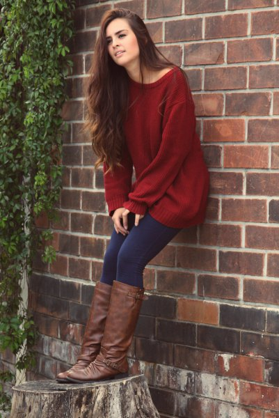 dark red boat neck tunic sweater with navy blue leggings and knee high boots