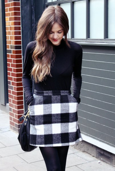form fitting sweater with black and white plaid wool mini skirt