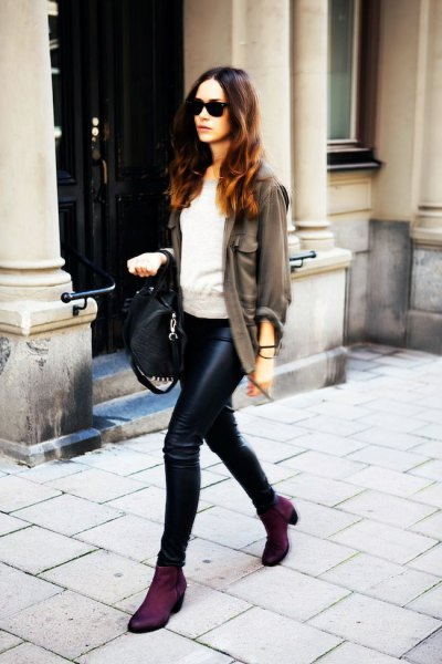 grey blazer with light grey sweater and leather pants