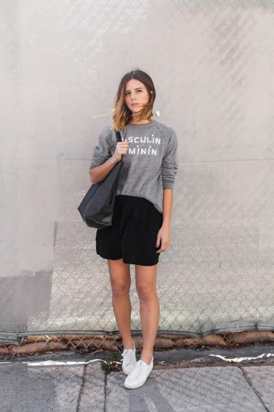 grey crew neck graphic sweatshirt with black mini wrap skirt