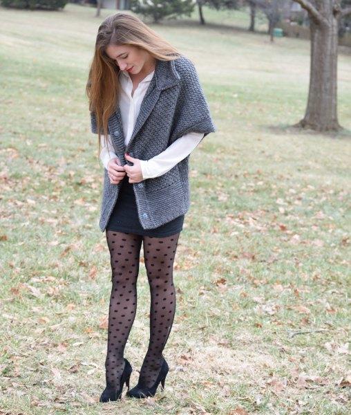 grey half sleeve cardigan with black mini bodycon skirt and polka dot tights
