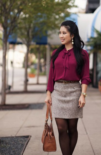 grey tie neck blouse with mini skirt and brown tights