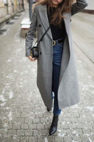 grey walker coat with blue high rise skinny belted jeans