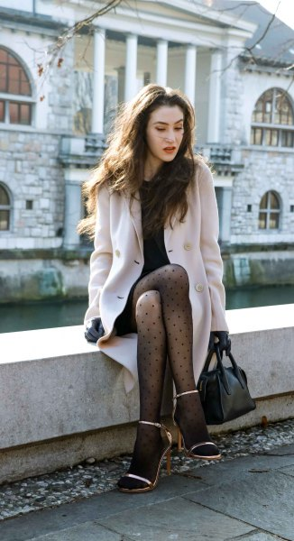 light pink long wool coat with polka dot stockings and heels